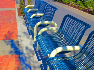 blue benches on board walk